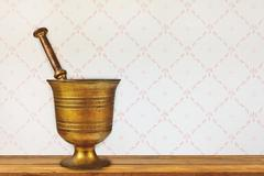 Vintage mortar on an old wooden table Stock Photos