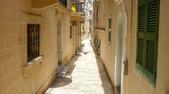 Typical narrow street with stairs in the city Valetta on the island of Malta Stock Footage