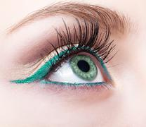Female eye zone and brow with evening green eyeliner makeup Stock Photos