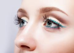 Female eye zone and brows with evening green eyeliner makeup Stock Photos