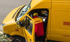 DHL Delivery yellow van Stock Photos