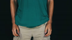 Man Turns the Empty Pockets of His Shorts. No Money Stock Footage