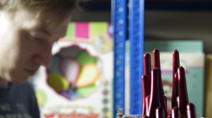 Picking a Set of Paintbrushes from a Shelf Stock Footage