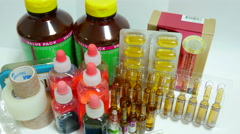 Some Medicines and Injector displayed, White Background, Pan, 4K Stock Footage