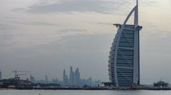 Dubai skyline with Burj Al Arab hotel during and day to night timelapse Stock Footage