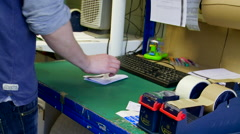 Packing an Item into a Small Postage Envelope Stock Footage