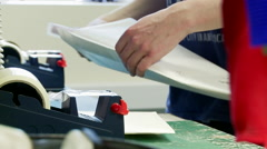 Shop Employee Packs Diary in a Large Jiffy Bag Stock Footage