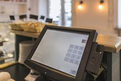 Close-up of checkout counter in coffee shop - stock photo