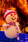 Snowman in hell - stock photo