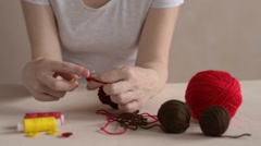 Crocheting woman. Soft focus - stock footage