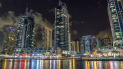 View of Dubai Marina Towers and canal in Dubai night timelapse hyperlapse - stock footage