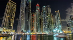 Close View of Dubai Marina tallest Towers in Dubai at night timelapse - stock footage