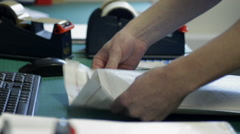 Packing an Item in a Large Postage Envelope Stock Footage