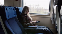 People with smart phone traveling in train on commute. Passengers using Stock Footage