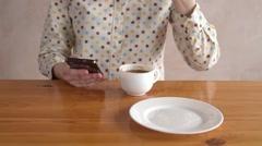 Girl drinks coffee and eats a bun Stock Footage