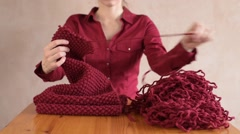 Girl unravelling the red scarf Stock Footage
