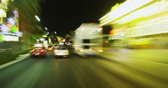 Driving along Las Vegas Blvd at Night POV in Time Lapse Stock Footage