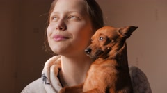 Teen girl with a little doggy friend. 4K UHD - stock footage