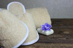Slippers and a towel. - stock photo