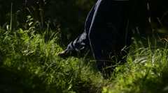 Girl dancing in the green grass. Visible only to the legs. Stock Footage