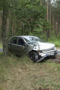 Damaged car on roadside Stock Photos