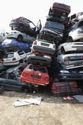 Cars stacked in scrap yard Stock Photos