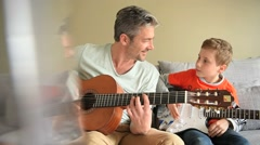 Daddy with son playing the guitar - stock footage