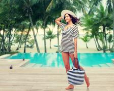 happy young woman in summer clothes and sun hat - stock photo