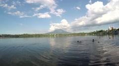 Boys swim in lake water Stock Footage