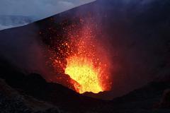 Scenery night eruption volcano on Kamchatka Peninsula. Russian Far East Stock Photos