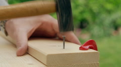 Do it yourself, nailing in slow motion - stock footage