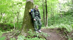 Tourist woman walking through the forest. wild. camping. leisure. hiking. Stock Footage