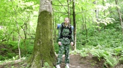 Tourist woman walking through the forest. hiking. Green Forest. adventure begins Stock Footage