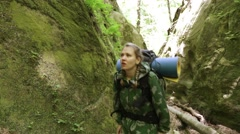 Woman tourist is among the rocks. Overcoming obstacles. Hiking. Stock Footage