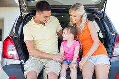 happy family with hatchback car outdoors - stock photo