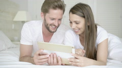 Young couple surfing the net with ipad Stock Footage