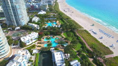 Pools palms and sands Miami Beach aerial video - stock footage