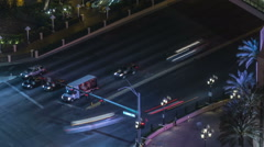 Night time aerial view of busy intersection time lapse slow shutter light trails Stock Footage
