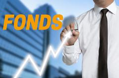 fonds (in german fund) trader distinguishes market price on touchscreen - stock photo