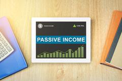passive income word on tablet - stock photo