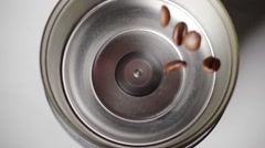 Coffee beans fall into the grinder, slow motion Stock Footage