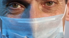 eye adult male doctor wearing a medical mask closeup smiling - stock footage