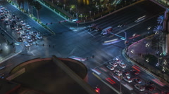 4K UHD Night time aerial view of busy intersection time lapse wide light trails Stock Footage