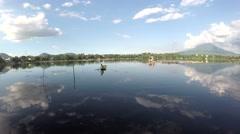 lake boatman paddles his bamboo raft - stock footage