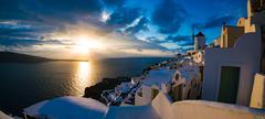Beautiful sunset in Oia village, Santorini, Greece Stock Photos
