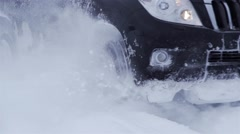 Passable black car moving in deep snow effect in slow motion Stock Footage