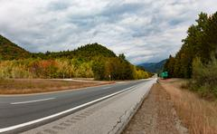 Speedway in autumn forest United States New Hampshire - stock photo