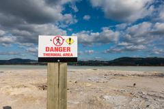 Thermal area danger shield in New Zealand Lake Rotorua - stock photo