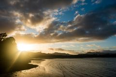 Sunrise in sea bay New Zealand Stock Photos