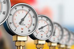 Row of industrial high pressure gas gauge meters - stock illustration
